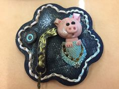 Polymer clay broch with pig in pocket