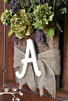 Flowers welcome guests nested in a basket. The monogram lets you know you're probably in the right place, and is a great use for the current trend of letter graphics.