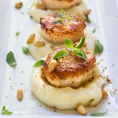Seared scallops over parsnip puree. Seared scallops over parsnip puree - buttery scallops served atop a luscious sweet parsnip puree spiced with nutmeg & toasted pine nuts. Fish Recipes, Seafood Recipes, Cooking Recipes, Healthy Recipes, Appetizer Recipes, Appetizers, Healthy Scallop Recipes, Fancy Recipes, Healthy Food