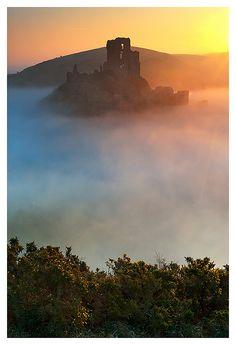 Corfe Castle sunrise in mist, Dorset, England