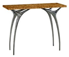 The Flying Buttress II, Console, Materials: Waterfall Bubinga veneer, Aluminum. From Traditional Home's New Keno Furniture Collection