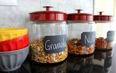 Organize cereal, crackers, etc in glass jars on shelves, paint the lids to coordinate with your kitchen and then make chalkboard labels with chalkboard spray paint and stencil (ot painters tape)