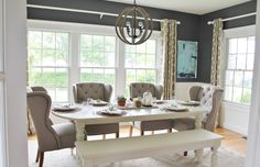 Navy Blue Walls, Tufted Linen Chairs, White Farmhouse Table and Abstract DIY Art in the Dining Room