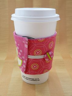 I've started making some of these cute coffee cozies to sell at the coffee shop.