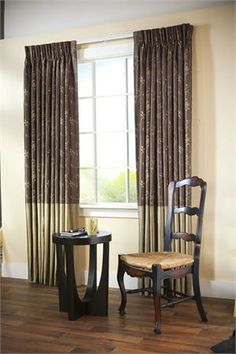 Two tone style custom drapery panels -nice effect of changing fabric from embroidery pattern on top and then solid fabric on bottom from window sill to floor