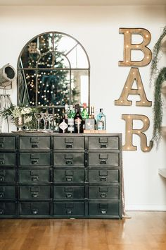 Nkuku Drawers With Industrial Mirror And Light Up Bar Lights - Gemma's Modern Industrial And Rustic Christmas Apartment Tour