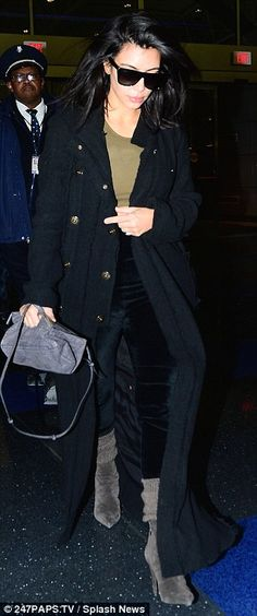 Wrapping up warm: Kim arrived in a long wool coat and cosy socks tucked into her grey suede ankle boots
