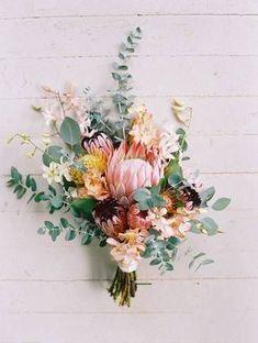 Spring Flower Arrangements pink, orange, and green floral wedding bouquet   Style Me Pretty via Domino #weddingflowerarrangements #weddingbouquets