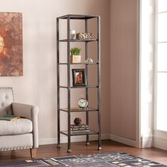 Crafted from metal and glass and showcasing an open design, this eye-catching eragere brings a distinctive touch to any space. Use it to display heirloom chine in the dining room or charming flea-market finds in the den.