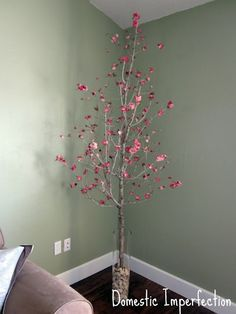 ".:* L - Cut cherry blossom type tree -- but it would be easy enough to swap out the branches and/or flower picks to suit your decor [""Dead Tree + Fake Flower Awesomeness"" — Domestic Imperfection]"