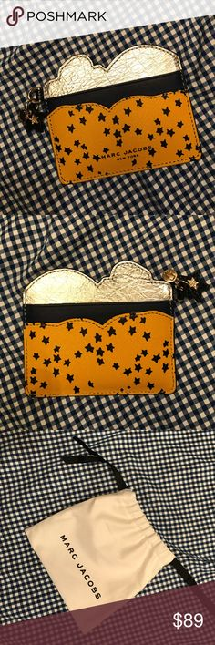 """Marc Jacobs Star Print Cardcase Colorblocked laser-cut leather case with star print. Four credit card slots. 4.5""""W X 3.5""""H. Leather/metallic leather. Never used. Marc Jacobs Accessories Key & Card Holders"""
