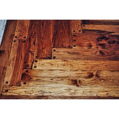 Hand Scraped Rustic Pegged Hickory. Done by Todd's Hardwood Flooring.
