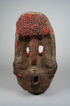 Mask; wood, abrus seeds, resin.Nigeria, Benue River Valley region