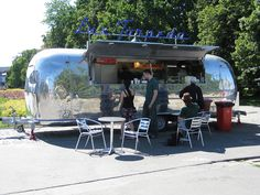airstream food truck with seating area