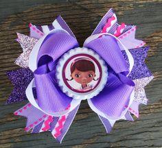 Doc Mcstuffins hair bow girls cute bottle cap boutique headband stripes lavender hot pink doc and lambie hairbows via Etsy