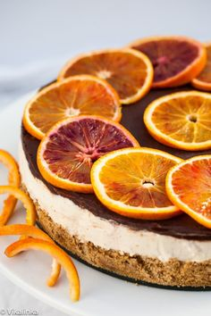Blood Orange Cheesecake (no bake)-creamy filling flavoured with a vanilla bean and blood oranges, glazed with a chocolate ganache and set on a oatmeal cookie crumb crust