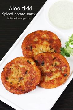 Aloo tikki is a popular Indian snack made with boiled potatoes & spices. They are eaten with green chutney or can be topped with yogurt & chutney Aloo Recipes, Veg Recipes, Indian Food Recipes, Cooking Recipes, Indian Potato Recipes, Vegetarian Indian Foods, Snack Recipes, Cooking Pasta, Cooking Fish