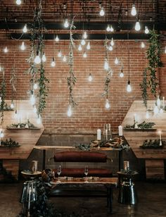 Wood + Water Wedding Inspiration // Industrial Wedding Backdrop with Brick Hanging Lights and Hanging Leaf Eucalyptus #weddingbackdrop #hangingflorals