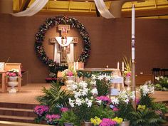 Mix palms from palm sunday in with the Easter Garden Altar display the color variety of flowers. Contemporary Flower Arrangements, Easter Garden, Altar Decorations, Easter Season, Easter Flowers, Church Flowers, Palm Sunday, Easter Celebration, Easter Wreaths