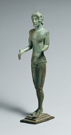 Etruscan bronze standing male figure ca.450 B.C. The bronze is especially interesting for its remarkable stylistic affinities with Etruscan art.