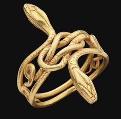 A GRAECO-ROMAN GOLD SNAKE RING   CIRCA 1ST CENTURY B.C.-1ST CENTURY A.D.   Composed of two coiling snakes, their heads turned out on either side, their bodies forming a Herakles knot at the centre, details incised  1½ in. (3 cm.) wide