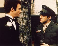 """Sonny Corleone (James Caan) and Michael Corleone ( Al Pacino) in the wedding scene from """"The Godfather. The Godfather Poster, The Godfather Part Ii, Godfather Movie, Godfather Quotes, Young Al Pacino, Corleone Family, Annie, Crime Film, Sibling Rivalry"""