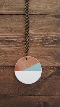 This listing is is for a modern wood pendant necklace. Each wood pendant is stained by hand. Each painted section is painted by hand and then
