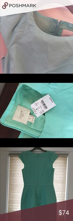 NWT J Crew Suiting Turquoise Dress Size 4 NWT J Crew Suiting Turquoise Dress Size 4. I had a really hard time getting the color to photograph accurately. It's really like the photo with the tag. Such a beautiful color! New with tags. Pockets on the front are still sewn shut. (It has pockets!) Has cap sleeves and a band of fabric around the waist for definition and structure. Perfect work dress for spring and summer! J. Crew Factory Dresses