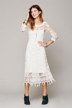 Beach Babe Seaside nuptials call for breathable threads that play well in the sand and make you feel like Amphitrite. Free People Daisy Chemical Lace Dress, $268, available at Free People.