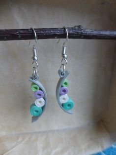 These earrings are made of rolled paper strips. My creations are protected by a layer of varnish, however it is best not left in contact with water too long.