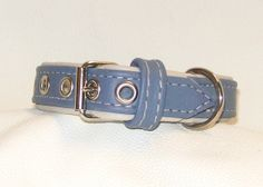 pale blue on cream leather dog collar by www.wtsy.co./uk/shop/newforestcrafts