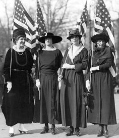 Despite the threat of incarceration, Suffragettes continued to march with American flags in protest, circa 1910.