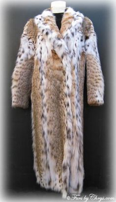 SOLD! Plus Size Ankle Length Montana Lynx Fur Coat #L508; Size range: 16 - 20; Excellent condition. This is a spectacular genuine natural Montana lynx fur coat in a hard-to-find plus size and in the luxurious ankle length. The markings on this fur are sensational, and there is an abundance of the white belly fur which makes it even more valuable. If new, this lynx coat would retail for approx. thirty thousand dollars! It has a David Green label and features a large shawl collar.