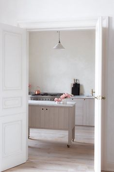 natural modern vintage kitchen with marble and plaster walls