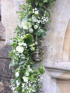 The beautiful chapel on the Orchardleigh Estate. Both arches looked lovely with white and green garlands of roses, lisianthus and gypsophila. A truly magical wedding venue.