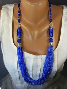 Long necklace made of Czech beads and seed beads of colored glass with a sparkling this draft law covering. Supplemented by large lampwork beads handmade. The main color is blue. Length 75 cm. Clasp - steel lobster.