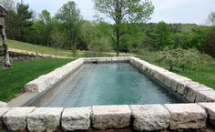 The large stone border gives this pool such a dramatic and beautiful touch.