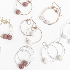 the cora hoops feature a single lava stone bead. they remind us of coral reef and sunny days, a nod to summer but beautiful for any season. available in silver, gold and rose gold with ivory, mauve or black stone. Bold Jewelry, Simple Jewelry, Confident Woman, Stone Beads, Simple Designs, Hoop Earrings, Rose Gold, Boutique, Silver