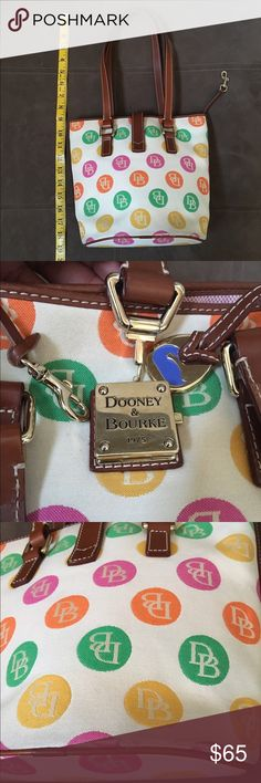 """Dooney and Bourke bucket bag(1) Dooney and Bourke bucket bag. Cream color with bubble yellow, green and pink. 19""""high from the straps to the base and 9"""" in width. Preloved.please observe the last two pictures- scurfs and a little stain at the base of the bag. Additional pictures in """"Dooney & Bourke (2)"""" listing.please check it out Dooney & Bourke Bags Shoulder Bags"""
