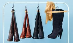 Leather boots hanging from BUMERANG trouser hanger
