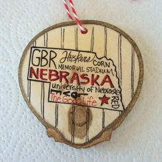 The good people, good life of Nebraska celebrated with this one of a kind wood slice ornament. Custom ornament for a Nebraska lover.
