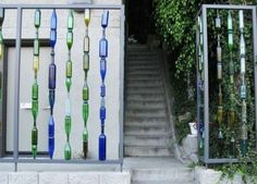 recycled garden art projects | Discarded glass bottles turned into a gorgeous fence for your garden ...