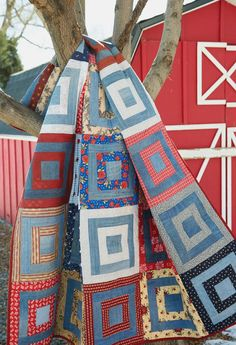 """This 60"""" x 72"""" throw-size quilt designed by Maria Umhey utilizes one block with denim and lots of different prints to make an easy, fast quilt."""