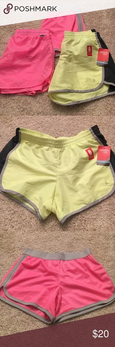 Workout Running Gym Shorts Four pairs of workout gym shorts NOT NIKE. The first neon yellow pair is brand new with tags never worn and has a hidden pocket. The other one in that picture is hot pink and stretchy juniors XL. They fit me and I wear a medium. The second pic is like the Nike mesh running shorts. Worn once hot pink with grey. Perfect condition. The third pic is hot pink a windbreaker running short material with spandex / compression shorts built in underneath.Worn once perfect…