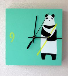 Brighten up your wall or desk space with this hand-printed wood clock. The clock face is printed with a pochoir technique, which uses multiple layers of stencils and paint to create the crisp lines and detailed images. On this one in particular, an upright panda stands on a green or red background, cradling a piece of bamboo, alongside the marker for nine o'clock.