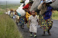 Congolese civilians flee the embattled town of Sake, on November 23 2012.