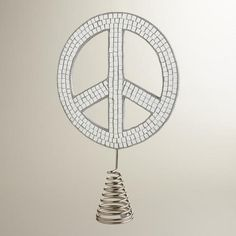 One of my favorite discoveries at WorldMarket.com: Mirror Peace Sign Tree Topper