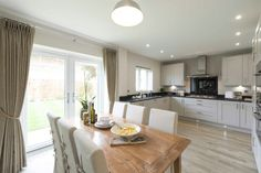 The open plan kitchen/dining room in our Garnet Show Home at #MeonVale. Isn't it lovely?