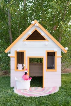 This playhouse is SO CUTE!!! I can't believe its a DIY!