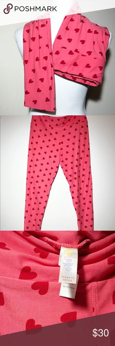 """LuLaRoe Pink Heart Legging Tall & Curvy Valentine LuLaRoe Leggings TC Tall & Curvy Valentine's Day Heart Pink & Red LOVE Wedding   Pink with red hearts. Almost a very soft """"simmer"""" to these leggings. Comfortable and stylish for any Valentine's Day date. Wear to a wedding, on a anniversary get a away. Possibilities for these soft stretchy leggings are endless. Maybe a day of Netflix and chill. Excellent condition. (A) LuLaRoe Pants Leggings"""